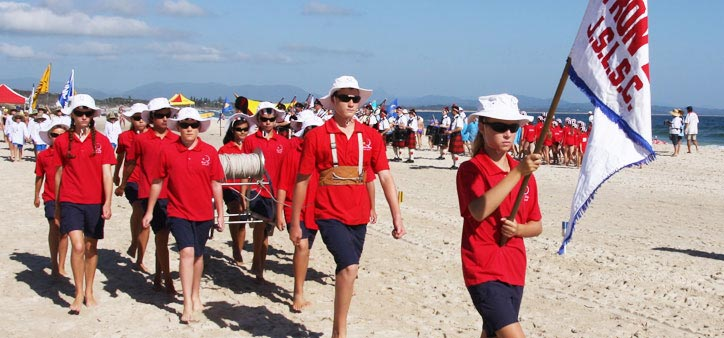 Byron Bay SLSC members in a march past. Photo: http://byronbaysurfclub.org